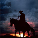 A Cowboy, A Tired Horse Under The Sunset